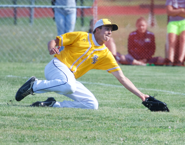 Shoreham right fielder John Montesano makes a sliding catch along the foul line in the fourth inning. (Credit: Robert O'Rourk)