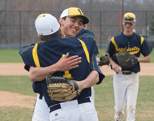 Shoreham-Wading River freshman Brian Morrell embraces coach Sal Mignano after throwing a no-hitter Friday against Mount Sinai. (Credit: Robert O'Rourk)