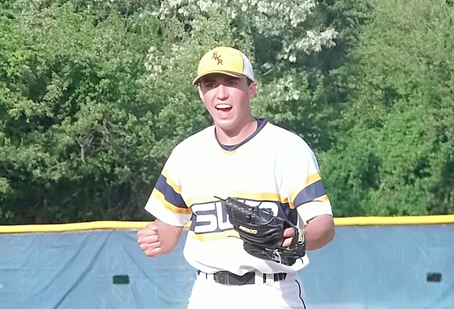Shoreham-Wading River sophomore Brian Morrell celebrates after striking out the final batter of the game in the Wildcats' Game 3 win over Glenn Tuesday. (Credit: Joe Werkmeister)