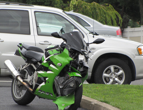 TIM GANNON PHOTO | The motorcycle and minivan after Saturday's crash.