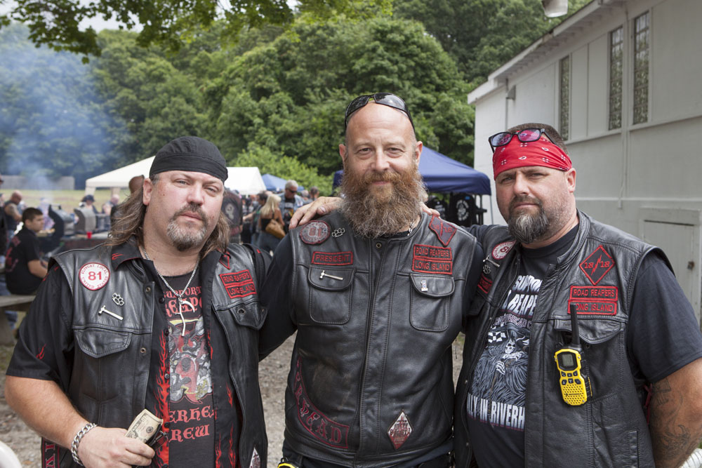 Road Reapers member L.J. James, left, with club president Lucky Lowe, center, and vice president Scott Krulder, right. (Credit: Katharine Schroeder)