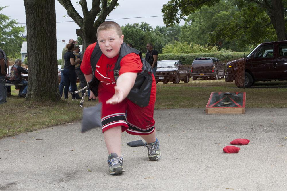 Jacob Cohen, 9, of Farmingville enjoys a game of bean bag toss. (Credit: Katharine Schroeder)