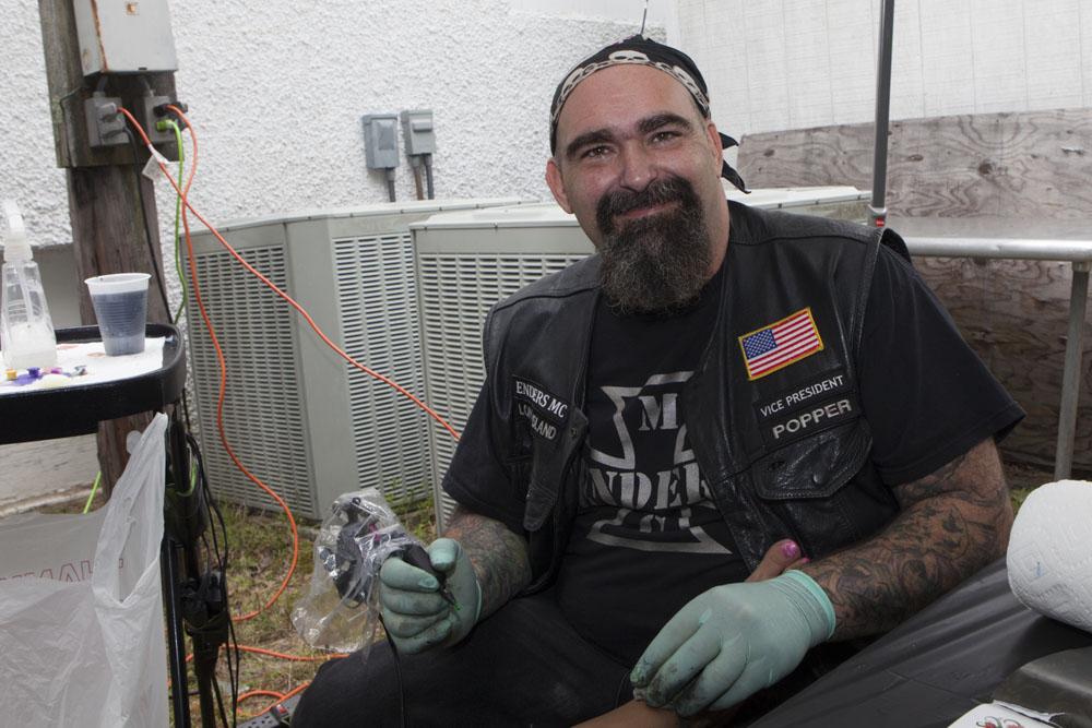 Gino Torres creating a tattoo. (Credit: Katharine Schroeder
