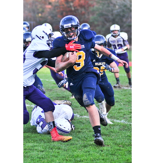 Shoreham-Wading River senior Nick Gray carries the ball against Port Jefferson Saturday. (Credit: Bill Landon)