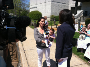 Andrea Zeledon-Mussio speaks with a reporters.
