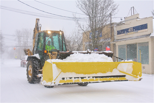 BARBARAELLEN KOCH PHOTO | Riverhead Town Building and Grounds manager Guy Cawley brings out the heavy equipment in Polish Town.