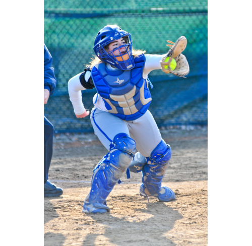 Riverhead senior Kayla Ormandy plays catcher in a game last season. (Credit: Bill Landon, file)