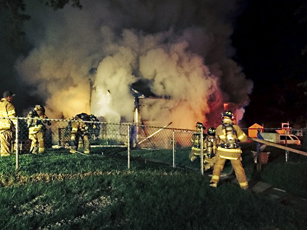 Firefighters battle a blaze that claimed a Northampton home just after midnight Thursday. (Credit: Riverhead Ex-chief Steve Beal)