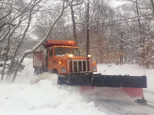 JOSEPH PINCIARO PHOTO | A highway crew plow makes its way through Wading River shortly after 8 a.m.