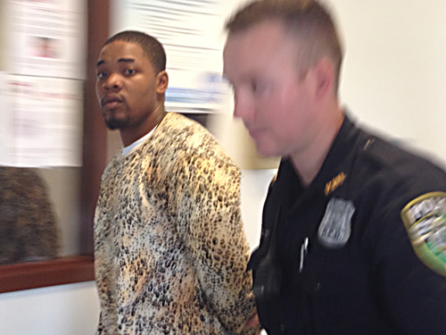 Trendell Walker is led by police out of his arraignment in Riverhead town court Friday morning. (Credit: Paul Squire)