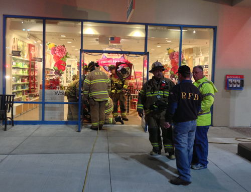PAUL SQUIRE PHOTO | Firefighters set up a fan to remove the rest of the smoke from a Tanger Outlet store.