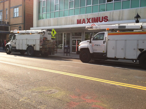 PSEG utility trucks in downtown Riverhead during Friday afternoon's power outage. (Credit: Mike White)