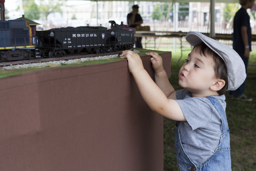 "Cameron O'Leary, 2, of Port Jefferson makes the ""choo choo"" sound effect as the train goes by. (Credit: Katharine Schroeder)"