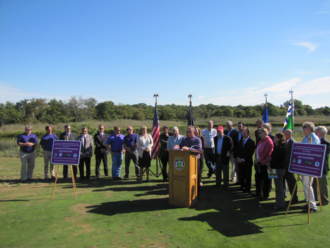 Elected officials, environmental groups and others gathered at a press conference on Riverhead's sewer treatment plant upgrade Friday at Indian Island golf course. Tim Gannon photo.