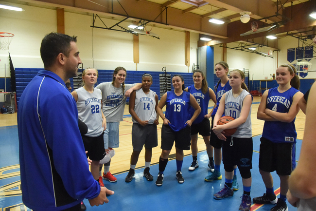 Riverhead girls coach Dave Spinella goes over instructions with the Blue Waves at practice. (Credit: Robert O'Rourk)