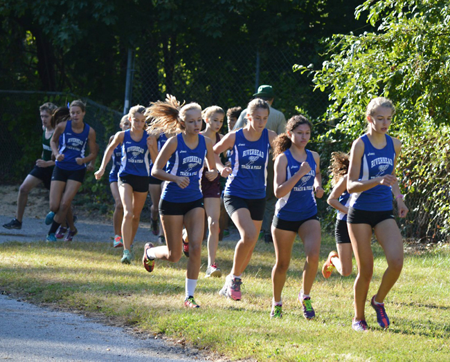 The Riverhead girls cross country team, pictured in a meet earlier in the season, improved to 3-1 with a win Tuesday. (Credit: Charles Christ)