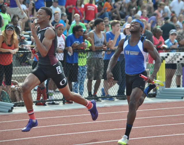 Riverhead senior Steven Reid III runs the final leg of the 4x100 relay at Friday's state championship meet. (Credit: Joe Werkmeister)