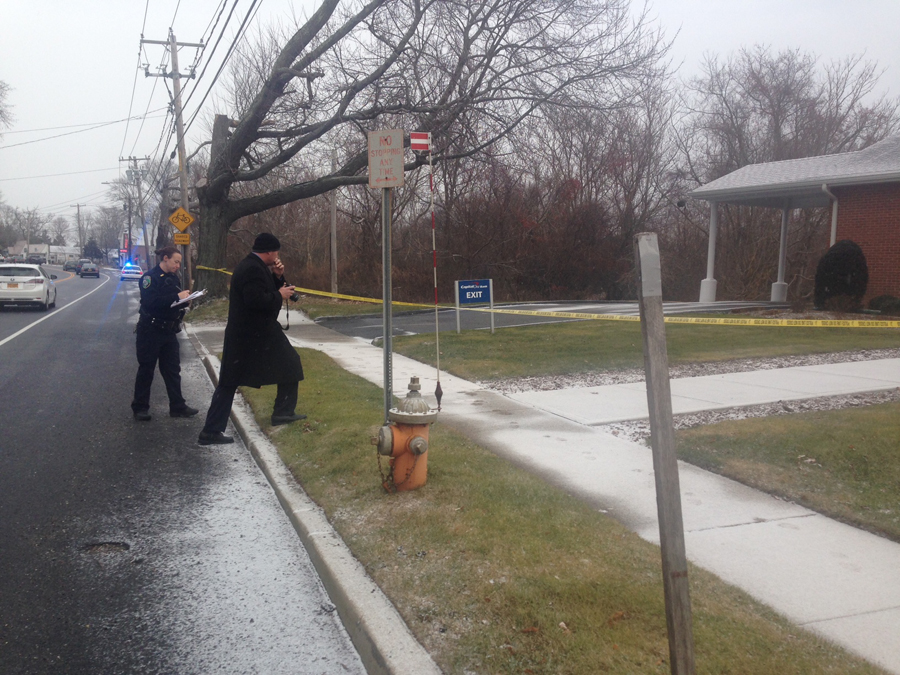 Police are investigating a robbery at Capital One bank in Jamesport. (Credit: Cyndi Murray)