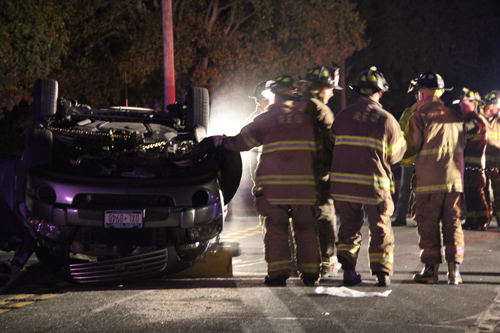 CARRIE MILLER PHOTO | About 50 fire department volunteers were called to the scene of the rollover accident Monday night.