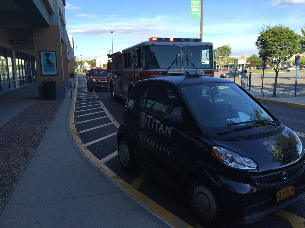 Firefighters park outside the Tanger 1 outlets during Monday's brief power outage. (Credit: Paul Squire)