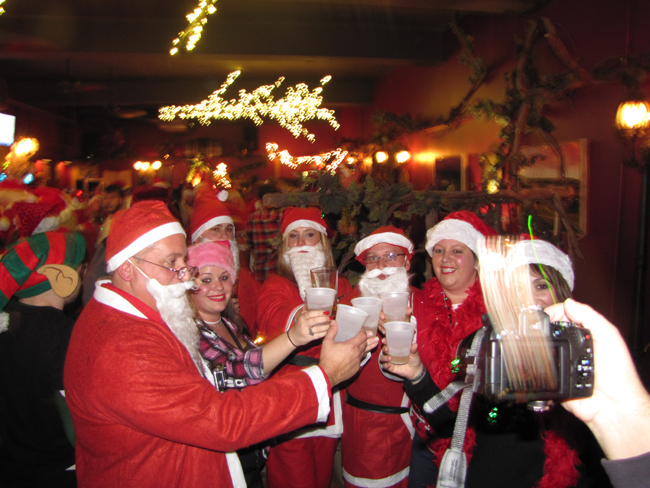Santa was everywhere Saturday night in Riverhead for Santacon. (Credit: Paul Squire)