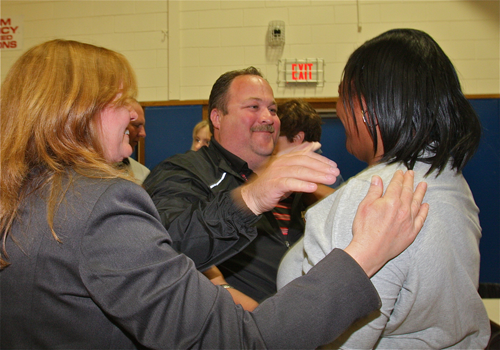 Superintendent Nancy Carney (left) and school board members Gregory Meyer and Kimberly Ligon after learning they were re-elected Tuesday. (Credit: Barbaraellen Koch)