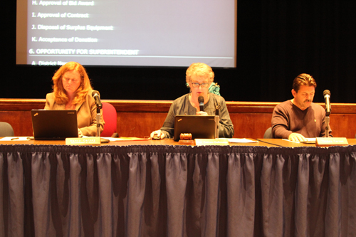 Riverhead superintendent Nancy Carney (left), board president Ann Cotten-DeGrasse and board member Thomas Carson at Tuesday night's meeting. (Credit: Jennifer Gustavson)