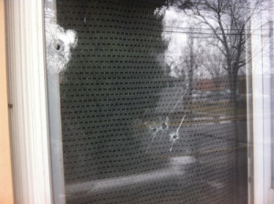 CARRIE MILLER PHOTO | Several bullets pierced the windows, though no one was hurt.