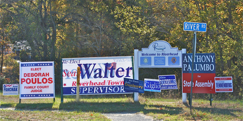 BARBARAELLEN KOCH PHOTO | A group of political signs on the corner of River Road and Route 25.