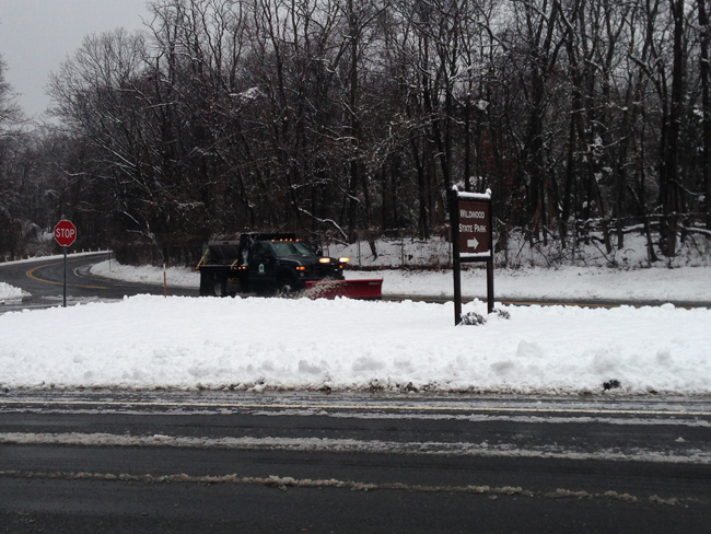 A plow clears snow near the entrance to Wildwood State Park in Wading RIver Saturday morning. (Credit: Joe Werkmeister)