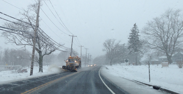 A plow clears snow on Main Road Friday. (Credit: Joe Werkmeister)