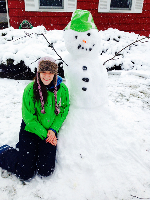 Angelika Osiniak enjoys a snow day on Ostrander Avenue in Riverhead.