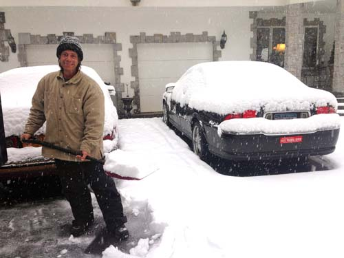 JOSEPH PINCIARO PHOTO | Phil Mondello of Wading River shovels out his driveway Monday morning.