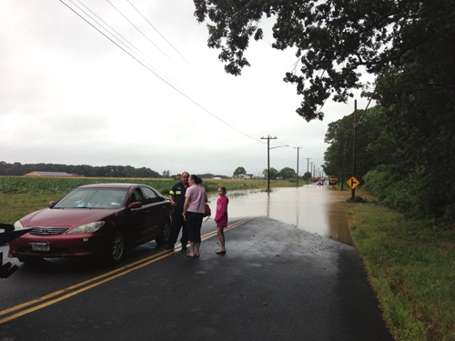 A car was pulled out of a flooded Sound Avenue this morning. (Credit: Paul Squire)