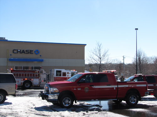 Firefighters briefly evacuated a bank after a fuel spill outside of it this afternoon. (Credit: Tim Gannon)
