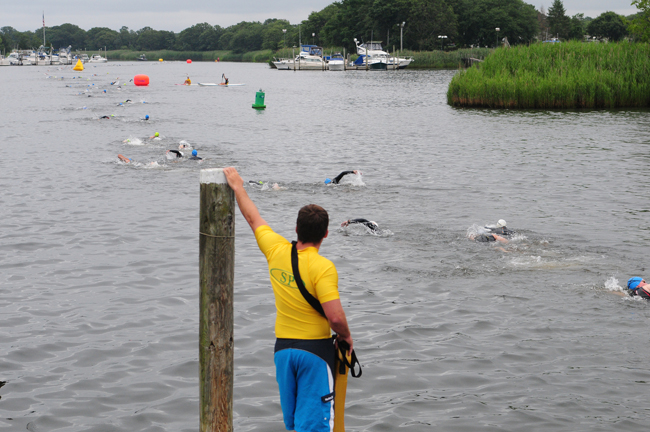 Swimmers race in the Riverhead Rocks Triathlon Sunday morning. (Credit: Bill Landon)