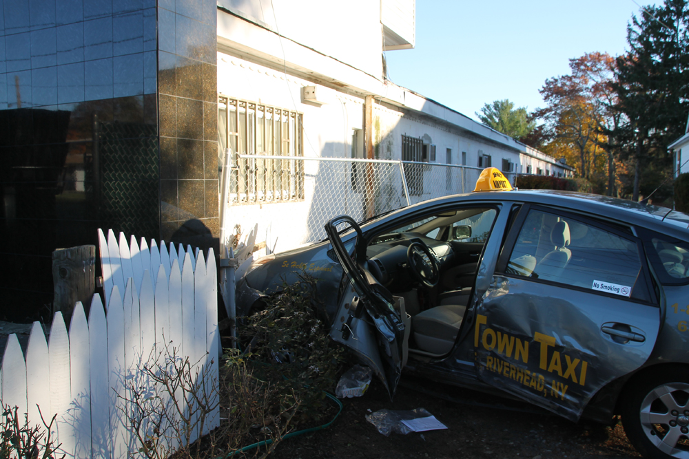 The taxi driver was taken to Peconic Bay Medical Center with a head injury. (Credit: Michael White)