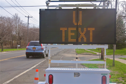 All across the East End, drivers were advised to stop texting while driving. (Credit: Barbaraellen Koch)