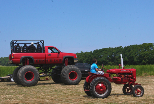 BARBARAELLEN KOCH PHOTO | A 2004 Chevy Silverado Monster truck owned by Leo Terrizzi of Bohemia was giving rides around the museum farm for $5.
