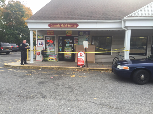 Riverhead Town Police are currently searching for a man who allegedly robbed Damaris Multi-Service on East Main Street on Sunday afternoon. (Credit: Grant Parpan)