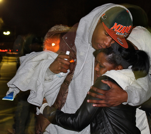 PAUL SQUIRE PHOTO | Mourners clung to one another for support during Thursday night's vigil for Demitri Hampton in Riverhead.