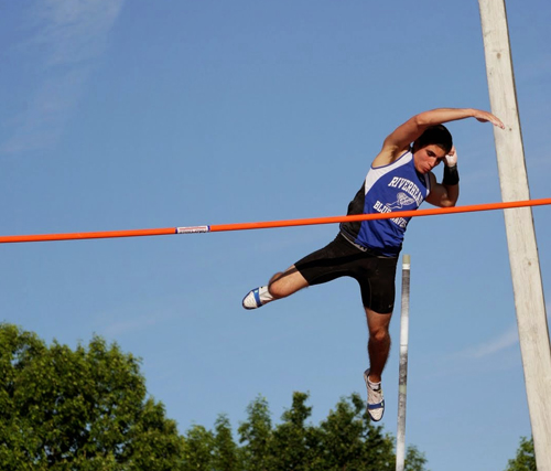 Riverhead senior Charles Villa clears 14 feet 6 inches in the pole vault Friday at the state championships in Syracuse. (Credit: Hal Henty)