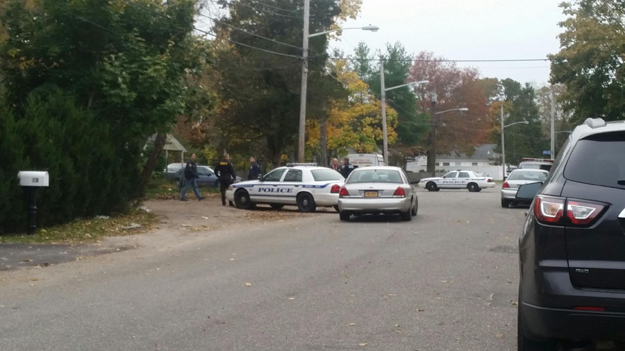 Several agencies helped with the search warrant execution on Lewis Street in Riverhead. (Credit: Carrie Miller)