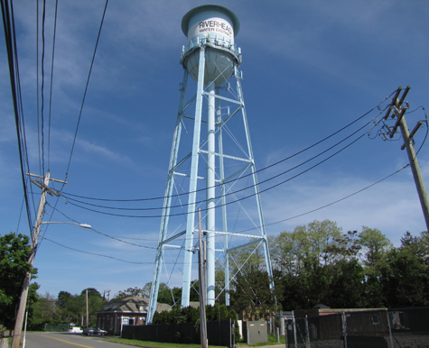 TIM GANNON PHOTO | The 'tin man' style water tower on Pulaski Street in Riverhead.