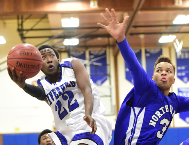 Riverhead's William Mitchell goes up for a shot against North Babylon's Tim Forbes. (Credit: Robert O'Rourk)