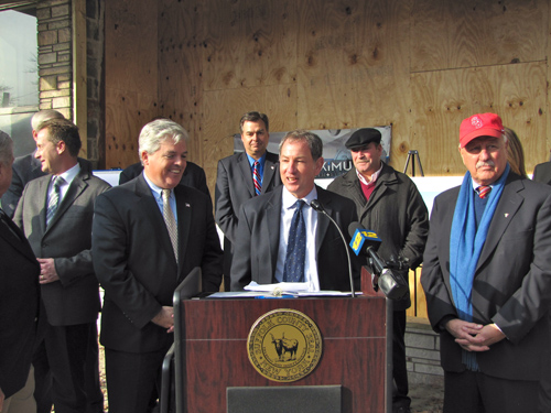TIM GANNON PHOTO | Michael Butler, center, who heads Woolworth Revitalization LLC, at a press conference on Tuesday to announce grants the project will get from county and state levels of government.