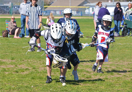 Youth lacrosse players scramble for a ground ball in Riverhead. Parents are proposing an artificial turf field be built at EPCAL. (Credit: Barbaraellen Koch, file)