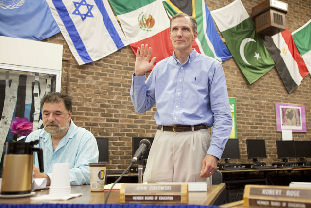 John Zukowski was sworn in last night as the SWR school board president. (Credit: Chris Lisinski)