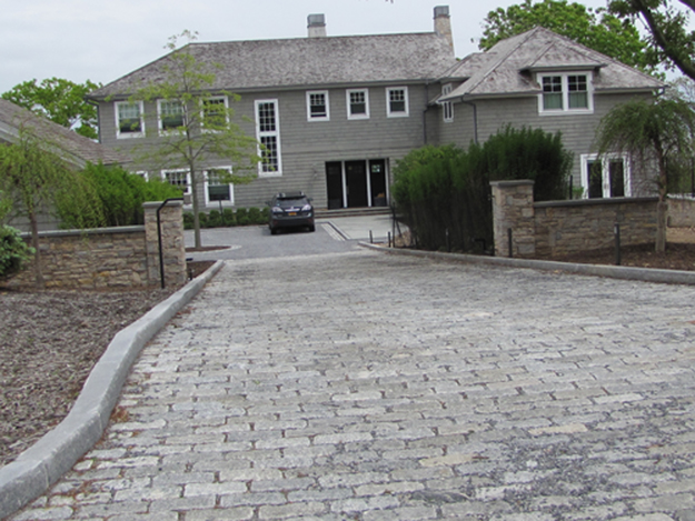 $400K driveway? Owners, landscaper in tangle of suits