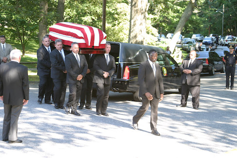 PETER BOODY PHOTO   Gov. Hugh Carey's casket is carried in to Our Lady of the Isle Church for a blessing before burial Thursday afternoon.